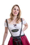 Young blonde woman in traditional bavarian costume on white background Royalty Free Stock Images