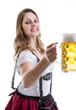 Young blonde woman in traditional bavarian costume on white background Royalty Free Stock Image