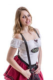 Young blonde woman in traditional bavarian costume on white background Stock Image