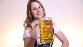 Young blonde woman in traditional bavarian costume on white background stock video