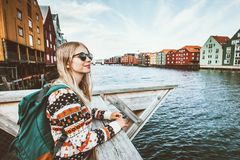 Young blonde woman traveling in Trondheim city Norway. Vacations weekend Lifestyle outdoor girl tourist with backpack sightseeing scandinavian architecture royalty free stock photo