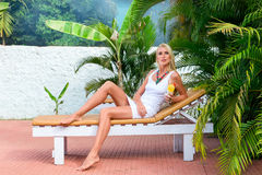 Young blonde woman at tropical resort Royalty Free Stock Photo