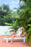 Young blonde woman at tropical resort Stock Photography