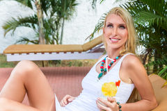 Young blonde woman at tropical resort Royalty Free Stock Image