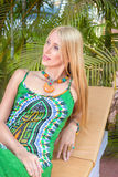 Young blonde woman at tropical resort Royalty Free Stock Photography