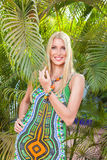 Young blonde woman at tropical resort Royalty Free Stock Photos