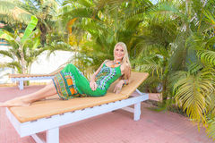 Young blonde woman at tropical resort Royalty Free Stock Images