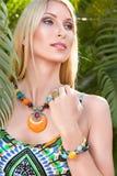 Young blonde woman at tropical resort Stock Photos