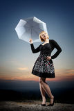 Young blonde woman with umbrella Royalty Free Stock Photography