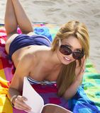 Young blonde woman vacationing at the beach. Young bikini clad woman vacationing at a Pacific coast beach ocean resort near San Diego, California, USA Stock Image