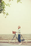 Young blonde woman on a vintage bicycle Royalty Free Stock Photos