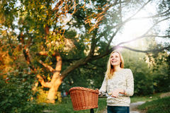 Young blonde woman on a vintage bicycle Royalty Free Stock Image