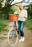 Young blonde woman on a vintage bicycle Stock Image