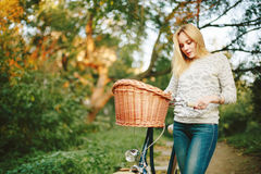 Young blonde woman on a vintage bicycle Royalty Free Stock Photography