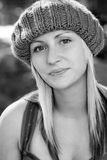 Young blonde woman wearing a knit hat Stock Photography