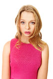 Young blonde woman wearing pink skirt Royalty Free Stock Photography