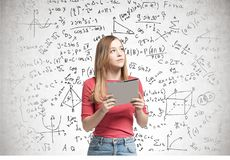 Blonde woman with a folder, formulas royalty free stock photography