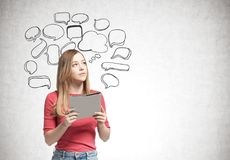 Blonde woman with a folder, speech bubbles royalty free stock image