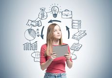 Blonde woman with a folder, time management royalty free stock image