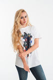 Young blonde woman in white t-shirt and jeans Stock Photos