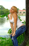 Young blonde woman in white tank top and jeans Royalty Free Stock Photo