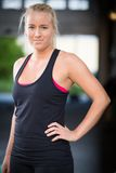 Young blonde woman in workout outfit Royalty Free Stock Photography
