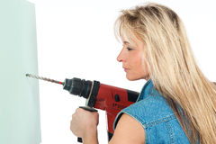 Young blonde woman works Stock Images