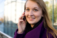 Young blonde women with mobile phone Royalty Free Stock Images
