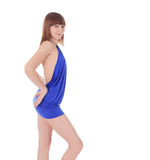 Young blondie in blue dress posing over white Royalty Free Stock Images