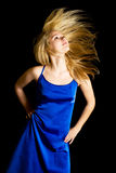 Young blondie girl. With spreading hair in the studio, black background Stock Image