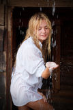 Young blondie at the rain Stock Photo