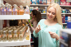 Young blondie shopping. Portrait of lovely young blondie shopping in beauty store Stock Images
