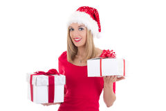 Young blondie woman in santa hat posing with gift boxes isolated Stock Photography