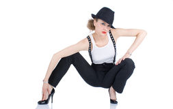 The young blondy girl with black hat Stock Photography
