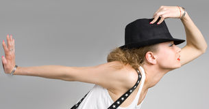 The young blondy girl with black hat Stock Images