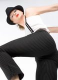 The young blondy girl with black hat Stock Photos