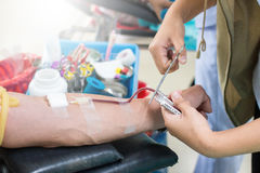 Young blood donor With pleasure. Donate blood using a needle in the arm Royalty Free Stock Photo