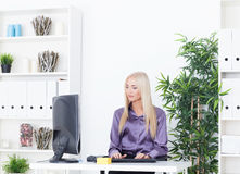 Young blounde beautiful business woman working with computer Royalty Free Stock Image