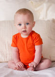 Young Blue Eyed Infant Boy Sitting up Looking at Camera Stock Images