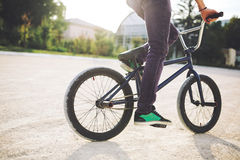 Young BMX bicycle rider. Having fun and posing. Bike close up Royalty Free Stock Photography