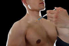 Young body building sportsman using steroids for increasing sport and athletic performance injecting syringe shoulder. Young body building sportsman using stock photo