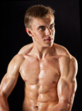 Young bodybuilder demonstrates posture Royalty Free Stock Photo