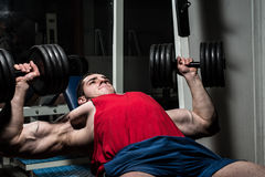 Young bodybuilder doing bench press for chest Stock Photo
