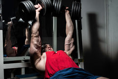 Young bodybuilder doing bench press for chest Royalty Free Stock Photo