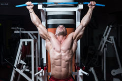 Young Bodybuilder Doing Heavy Weight Exercise For Back Royalty Free Stock Photos