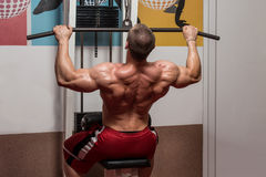 Young Bodybuilder Doing Heavy Weight Exercise For Back Stock Images