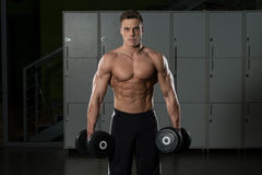 Young Bodybuilder Doing Heavy Weight Exercise For Biceps Stock Photo