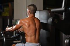 Young Bodybuilder Exercising Back On Machine Royalty Free Stock Photo