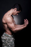 Young Bodybuilder Flexing Muscles Stock Photos
