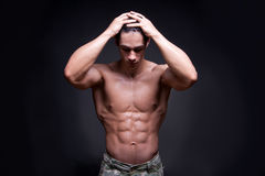 Young Bodybuilder Flexing Muscles Royalty Free Stock Images